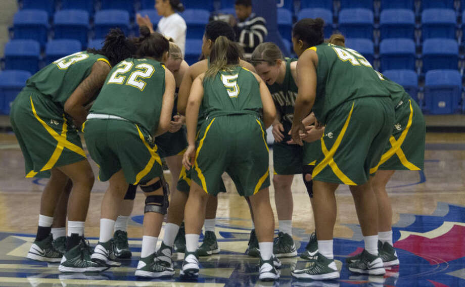 The Midland College Lady Chaparrals chant before the game against the Weatherford College Lady Coyotes during the NJCAA Region V Tournament earlier this month at the Rip Griffin Center in Lubbock. Photo: Brad Tollefson