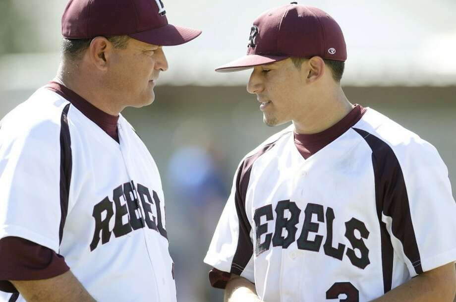 Lee baseball coach Hector Limon, seen here talking to his son Mick this past season, resigned from Lee to move back to Lubbock to be closer to his family. Limon will teach at Plainview Middle School and not coach.  Cindeka Nealy/Reporter-Telegram Photo: Cindeka Nealy