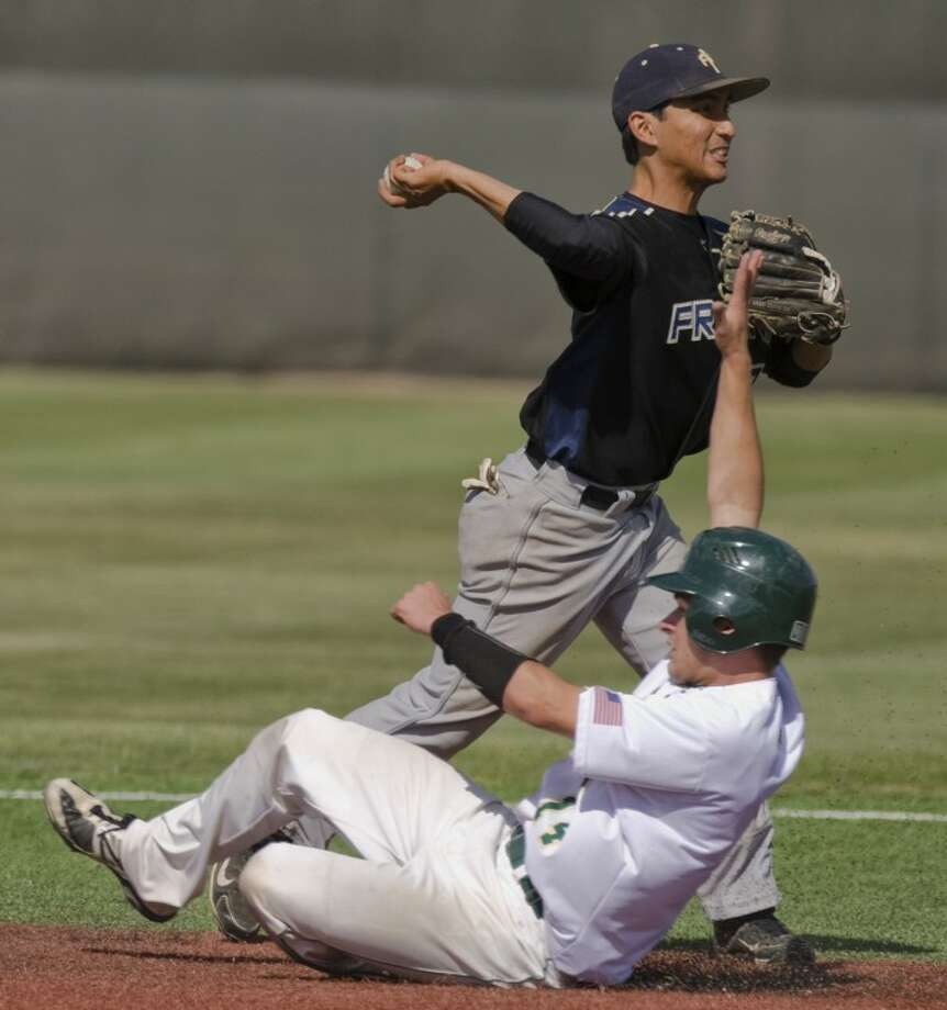 Frank Phillips Cesar Wong looks to turn the double play to first after making the force out at second on Midland College's Tyler Barlow but is too late on the throw to first Friday afternoon at Christensen Stadium. Photo by Tim Fischer/Midland Reporter-Telegram Photo: Tim Fischer