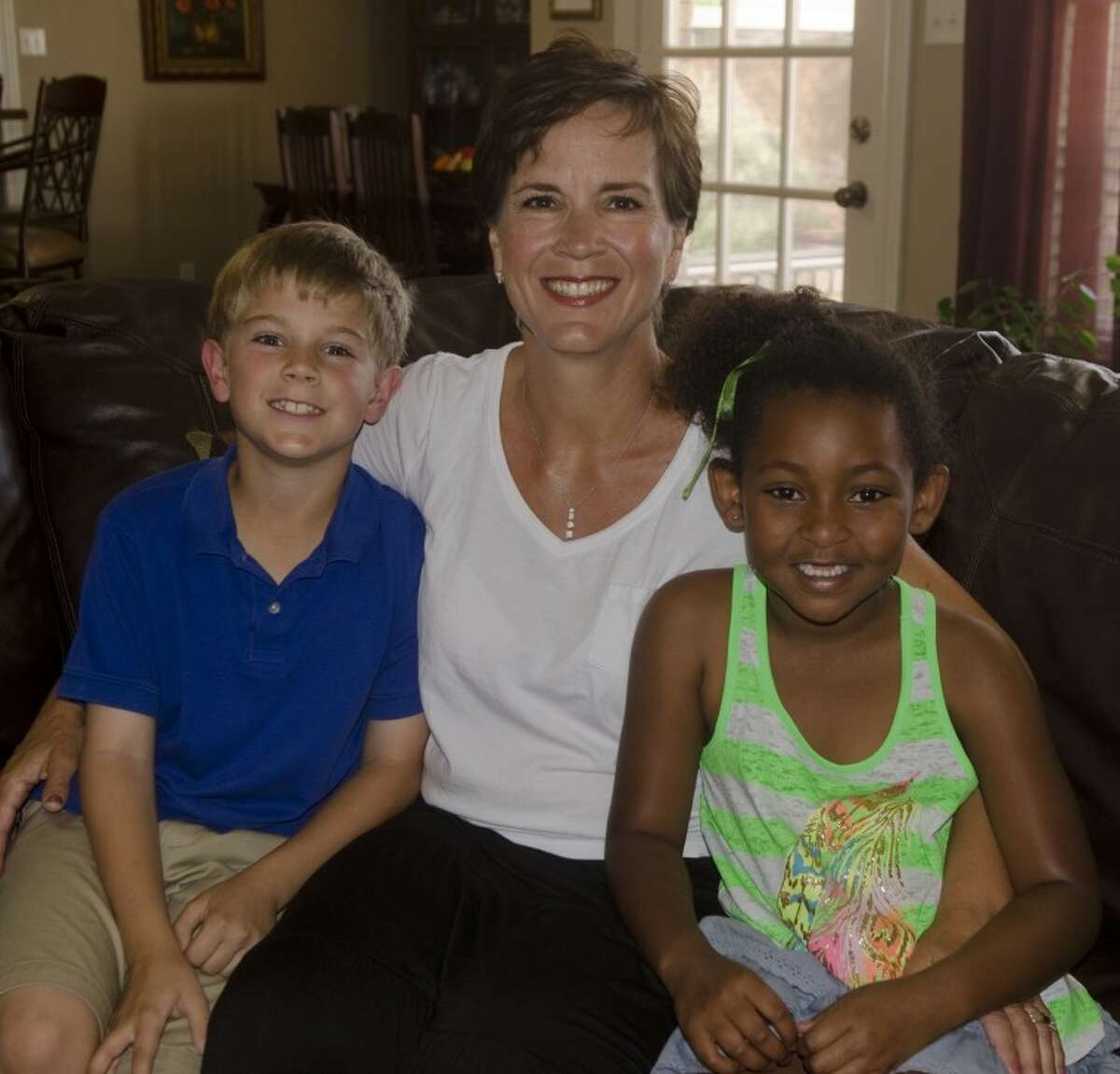 Becky Page with her son Carson and adopted daughter Kali. Photo by Tim Fischer/Midland Reporter-Telegram