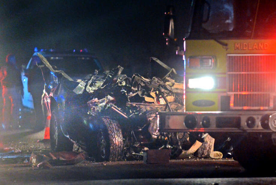 (File Photo) The remains of a pickup sit on the eastbound service road of I-20 after a collision with a tanker. The driver of the pickup was pronounced dead at 9:40 pm March 20. Photo: JAMES DURBIN