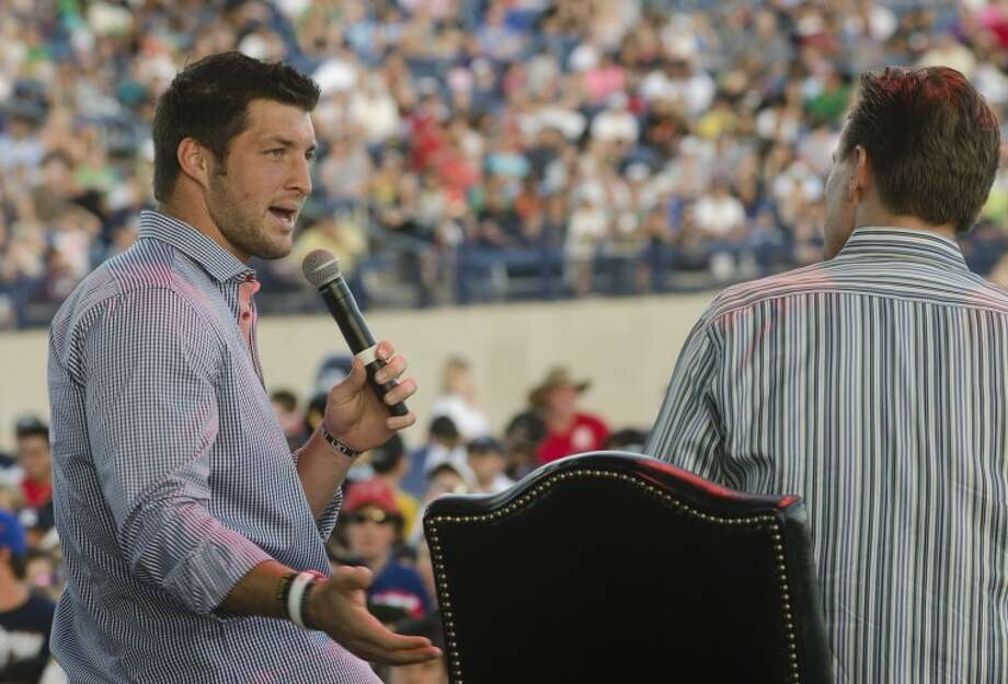 Tim Tebow sits down to talk with Pastor Patrick Payton, and a few thousand others Sunday at Grande Communication Stadium. Photo by Tim Fischer/Midland Reporter-Telegram Photo: Tim Fischer