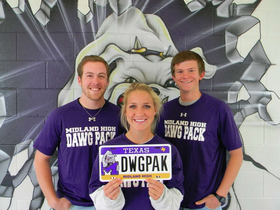 Dawg Pack: Midland High School Dawg Pack members Jackson Wilson, Annie Bergman and Stephen Reid pose with a custom license plate, available for sale beginning Wednesday at www.myplates.com. Midland High is the first high school in West Texas to have custom plates. Photo: Courtesy