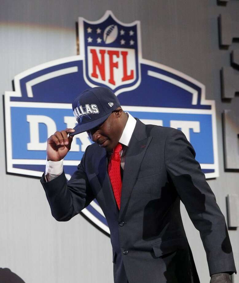 LSU cornerback Morris Claiborne walks on stage after being selected as the sixth pick overall by the Dallas Cowboys in the first round of the NFL football draft at Radio City Music Hall, Thursday, April 26, 2012, in New York. (AP Photo/Jason DeCrow) Photo: Jason DeCrow