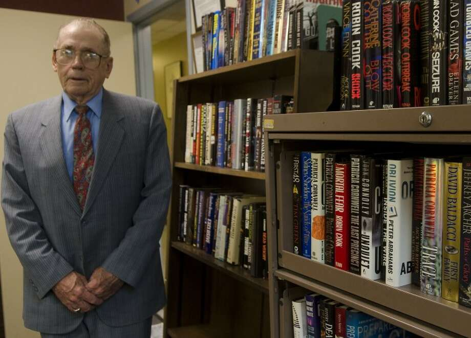 Bill Gaston stands by a small portion of his wife's book collection he has donated to Casa de Amigos in memory of her.  Photo: Tim Fischer Reporter-Telegram