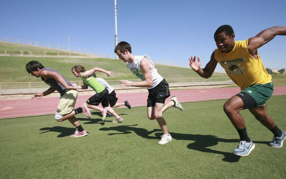 Members of the Andrews High School track team work out as they prepare to compete in the regional track meet. Cindeka Nealy/Reporter-Telegram Photo: Cindeka Nealy