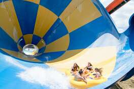 Residents enjoy the new Wet 'n' Wild SplashTown in Spring. The park is open Friday-Sunday though May 22 and will be open daily starting May 26.