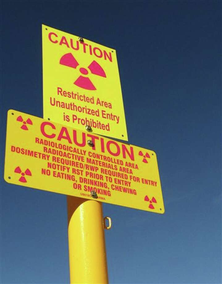 File - This Oct. 27, 2009 file photo shows a caution sign at Waste Control Specialists near Andrews, Texas. (AP Photo/Betsy Blaney, File) Photo: Betsy Blaney / AP2009