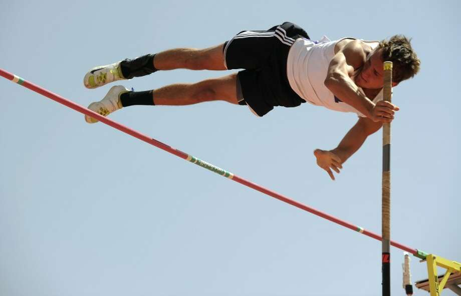 Midland High's Chase Jones pushes over the bar in the Region I-5A boys pole vault on Friday, April 27, 2012, at Robert Fuller Track in Lubbock. (Photo by Tommy Metthe) Photo: Tommy Metthe
