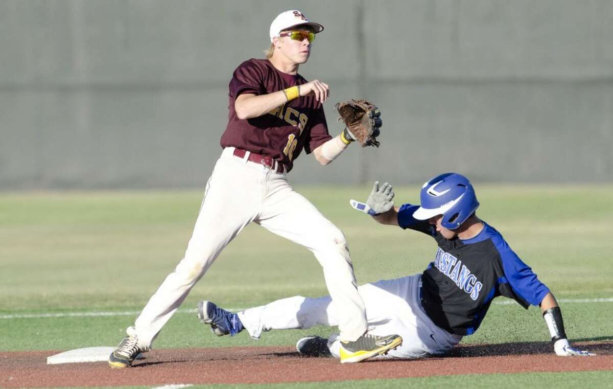 San Antonio Christian second baseman waits on the ball as Midland Christians Colton Chalker safely makes the steal, Friday during the first round of their TAPPS 4A baseball series at Christensen Stadium. Cindeka Nealy/Reporter-Telegram