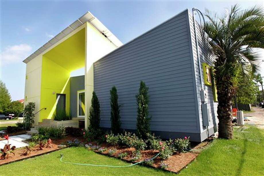 In a Thursday, April 5, 2012 photo, the Roese Sunshower SSIP house is seen in New Orleans. The house is meant to go up quickly after disasters and then serve as permanent housing that can withstand future calamities. It's designed to be environmentally friendly, survive outside damaged utility grids and can be shipped in pieces in a single container and assembled like an erector set. (AP Photo/Gerald Herbert) Photo: Gerald Herbert / AP