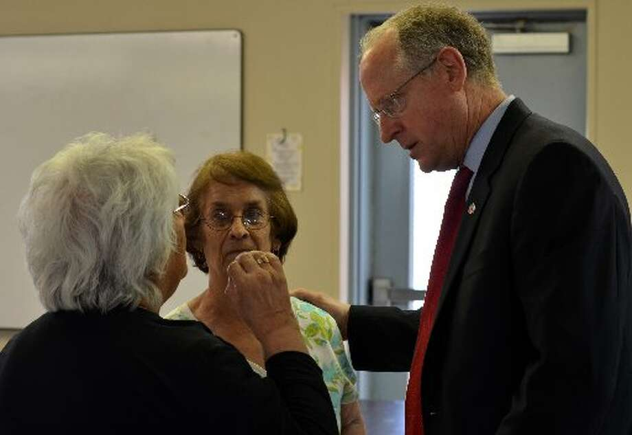 Isabel Gonzales (left) and Elidia Padilla meet with Congressman Mike Conaway after a town hall meeting Tuesday at Casa de Amigos. Conaway  primarily discussed tough budget issues facing the nation  Photo: James Cannon