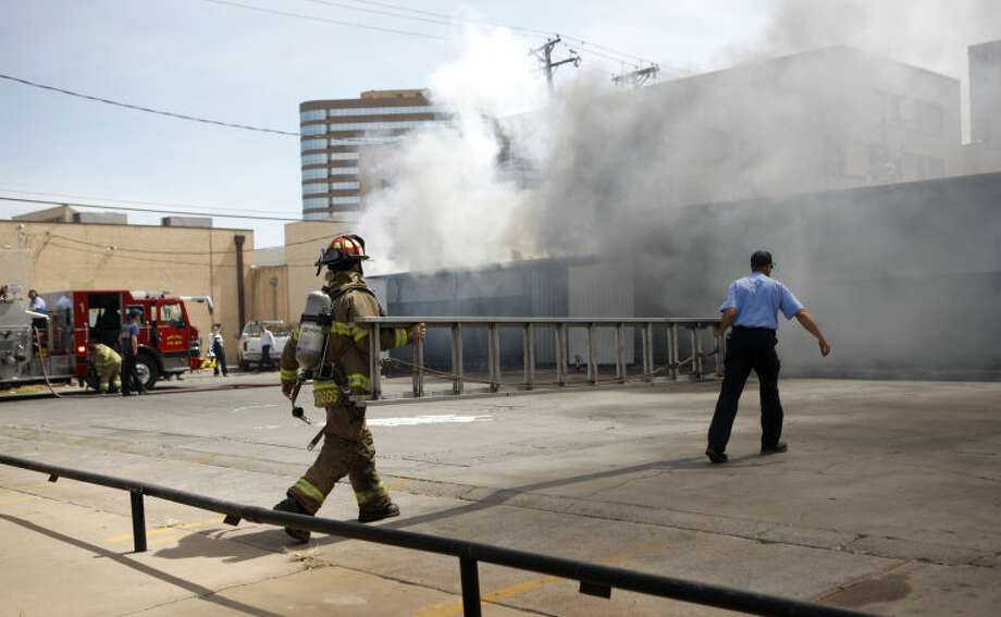 Midland fire department members work the scene of a fire at Johnny's Barbecue Wednesday. James Durbin/Reporter-Telegram Photo: JAMES DURBIN