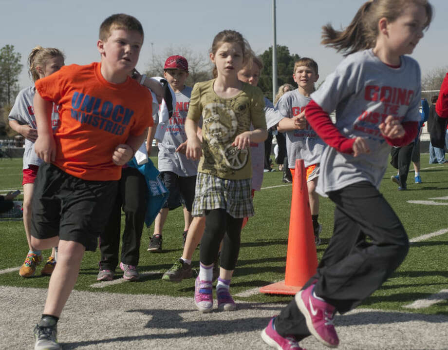 Midland Christian students run and walk around the football field Wednesday during the Mustang Run to raise funds for the school as students were sponsored per lap they completed. Tim Fischer\Reporter-Telegram Photo: Tim Fischer