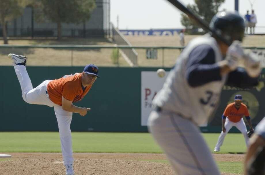 The RockHounds' A.J. Griffin delivers a pitch to Corpus Christi Hooks' Kody Hinze last season at CitiBank Ballpark. Photo by Tim Fischer/Midland Reporter-Telegram Photo: Tim Fischer