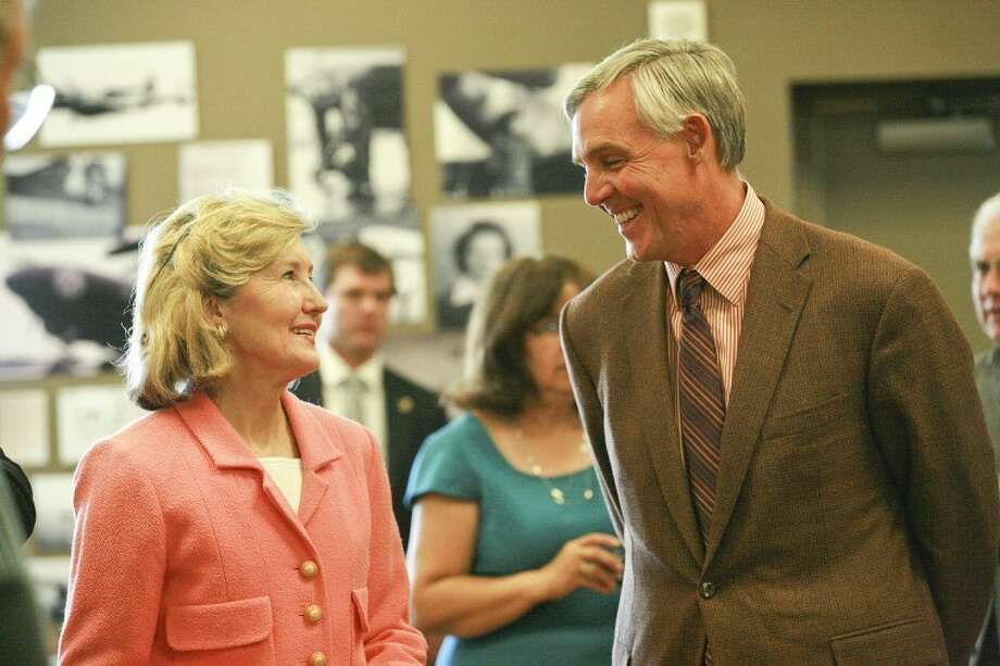 U.S. Senator Kay Bailey Hutchison, left, talks to Midland Mayor Wes Perry, Wednesday during an event in which the senator addressed area supporters and received thanks for her years of service at the Commemorative Air Force Gunfighters Pub. Photo: Cindeka Nealy