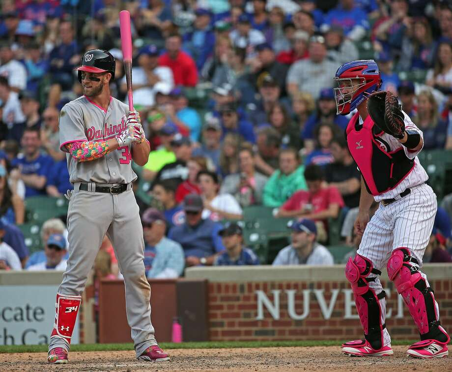 CHICAGO, IL - MAY 08: Bryce Harper #34 of the Washington Nationals is intentionally walked in the12th inning as David Ross #3 of the Chicago Cubs waits the pitch at Wrigley Field on May 8, 2016 in Chicago, Illinois. (Photo by Jonathan Daniel/Getty Images) Photo: Jonathan Daniel, Getty Images