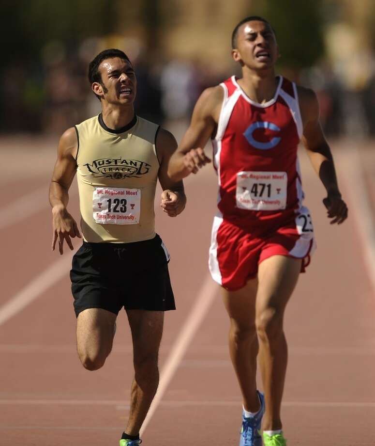 Andrews' Lucas Marquez (123) finishes just behind Fort Worth Castleberry's Gabriel Zambrano (471) in the boys 1,600m run at the Region I-3A track meet on Saturday, April 28, 2012, at Fuller Track in Lubbock. (Photo by Tommy Metthe) Photo: Tommy Metthe