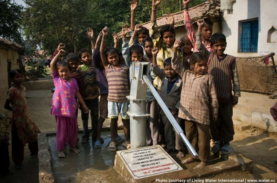 Children celebrate the completion of a Living Water International water well in India. Photo: Courtesy Of Living Water International