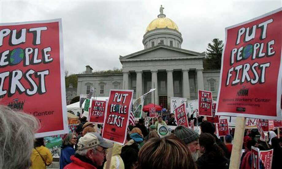 People rally at the Statehouse during a May Day protest on Tuesday, May 1, 2012 in Montpelier, Vt. The most visible organizing effort by anti-Wall Street groups since Occupy encampments were dismantled last fall were planned for May Day. From New York to San Francisco, organizers of the various demonstrations, strikes and acts of civil disobedience said they are not too concerned about muddling the message, noting that the movements have similar goals: jobs, fair wages and equality. (AP Photo/Toby Talbot) Photo: Toby Talbot / AP