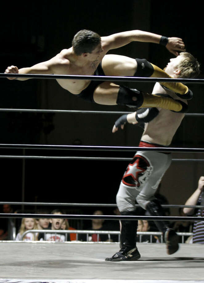 "Midlander Aaron Harmes, aka ""Cash Commodity,"" delivers a dropkick to opponent Ryan Justice during the ""Breaking The Silence"" wrestling event put on by Old School Wrestling of Odessa to raise awareness about bullying and teenage suicide. James Durbin/Reporter-Telegram Photo: JAMES DURBIN"