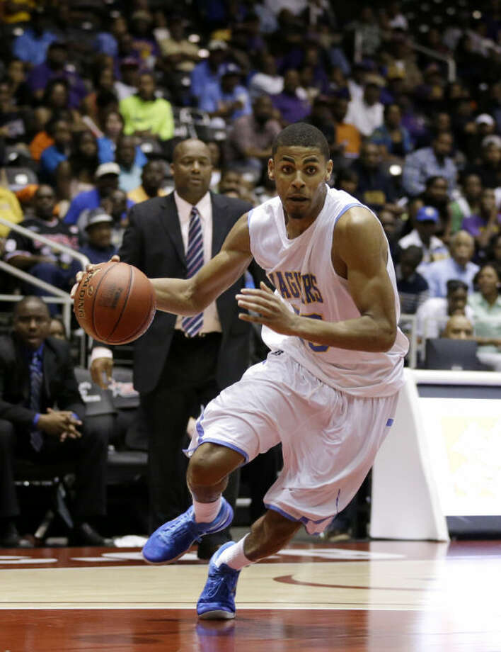 Southern's Malcolm Miller drives to the basket against Prairie View A&M during an NCAA college basketball game in the championship of Southwestern Athletic Conference tournament Saturday, March 16, 2013, in Garland, Texas. (AP Photo/Tony Gutierrez) Photo: Tony Gutierrez