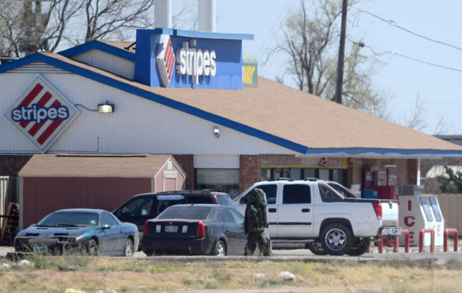 (Photo from the March 26 bomb call out) Midland emergency workers responded to a bomb threat at the Stripes location on Midkiff near I-20. James Durbin/Reporter-Telegram Photo: JAMES DURBIN