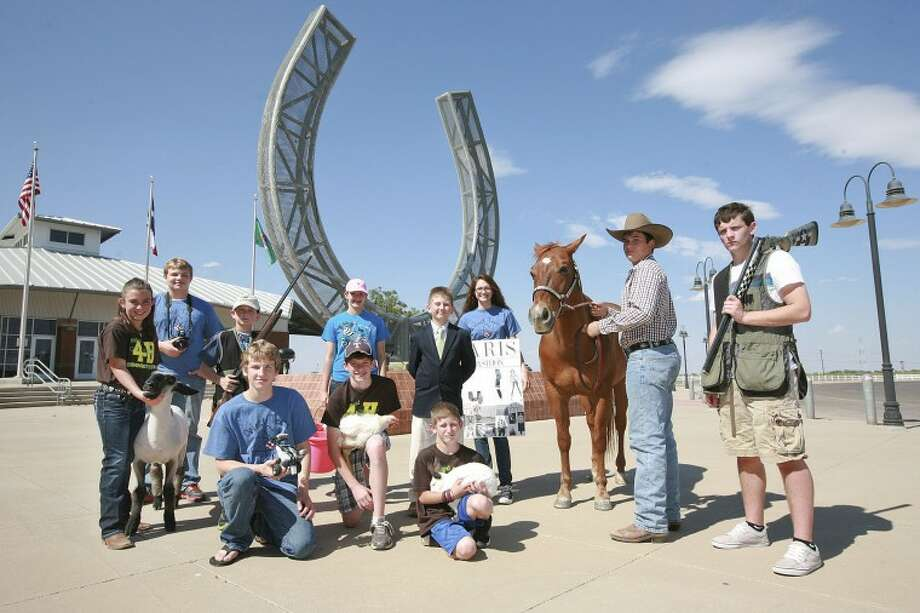 Area 4H participants, standing from left with their specialities in parentheses), Brooke Willhite, 11, (sheep); Alex Dalton, 15, (photography); Hud Hodnett, 10, (shotgun); Camryn Morrison, 13, (Steers); Brantly Hoover, 10, (Live Stock Judging); Emily Farmer, 16, (Fashion/Story Board); Daniel Dalager, 15, (Horse); Rhet Hodnett, 16, (shotgun) and kneeling, from left, Zach Dalton, 16, (robotics); Luke Cowan, 13, (Poultry) and Tab Cowan, 9, (rabbits). Cindeka Nealy/Reporter-Telegram Photo: Cindeka Nealy