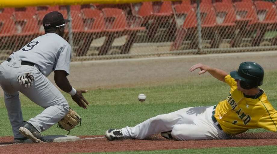Mdland College's Luke Slentz beats the throw as he safely slides into third as NMMI Elvis Perez reaches for the ball from the outfield Saturday at Christensen Stadium. Photo by Tim Fischer/Midland Reporter-Telegram Photo: Tim Fischer