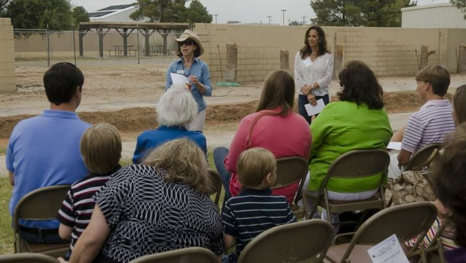Brooke Mueller, executive director of Midland Children's Rehabilitation Center and Laurie Boldrick, board president, welcome and thank everyone Monday in front of the area where the new Eric Hanson Equine Arena will be built. Photo by Tim Fischer/Midland Reporter-Telegram Photo: Tim Fischer
