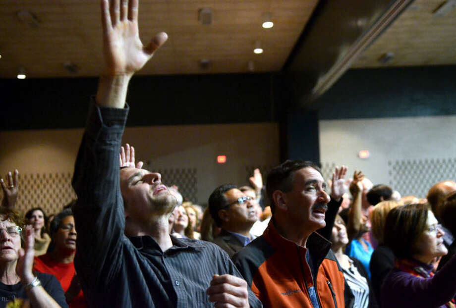 Attendees of the AWAKE 7:14 Prayer Revival worship Tuesday at the Midland Center. James Durbin/Reporter-Telegram Photo: JAMES DURBIN