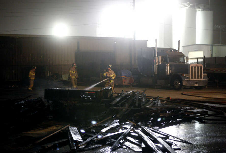 Midland fire fighters responded to a fire at 32 East Industrial Loop where a blown transformer sparked a fire on a trailer loaded with lumber Saturday. James Durbin/Reporter-Telegram Photo: JAMES DURBIN