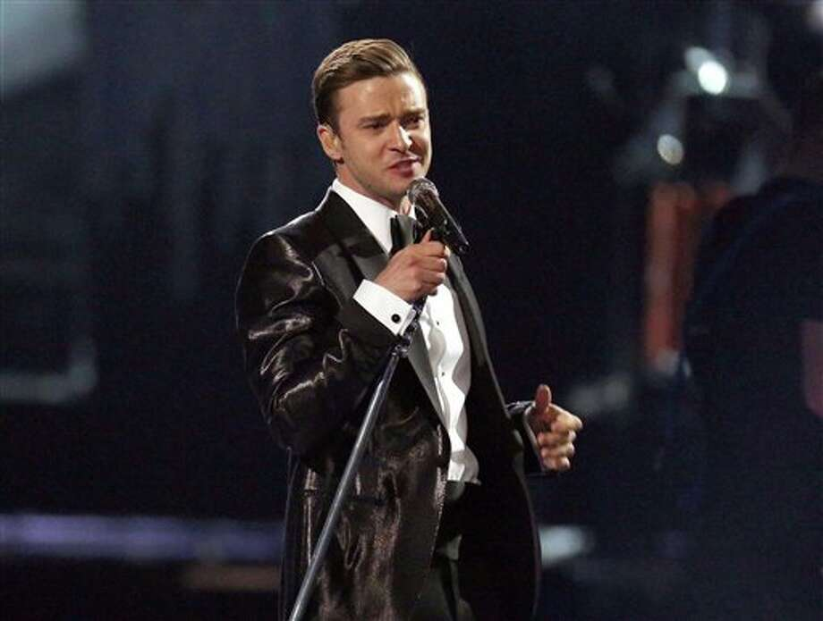 "FILE - This Feb. 20, 2013 file photo shows Justin Timberlake during the BRIT Awards 2013 in London. Nielsen SoundScan announced Tuesday, March 26, 2013, that the singer's third album, ""The 20/20 Experience,"" has moved 968,000 units. It's the 19th album in Nielsen's 12-year history that has sold more than 900,000 albums in a single week. (Photo by Joel Ryan/Invision/AP, file) Photo: Joel Ryan / Invision"