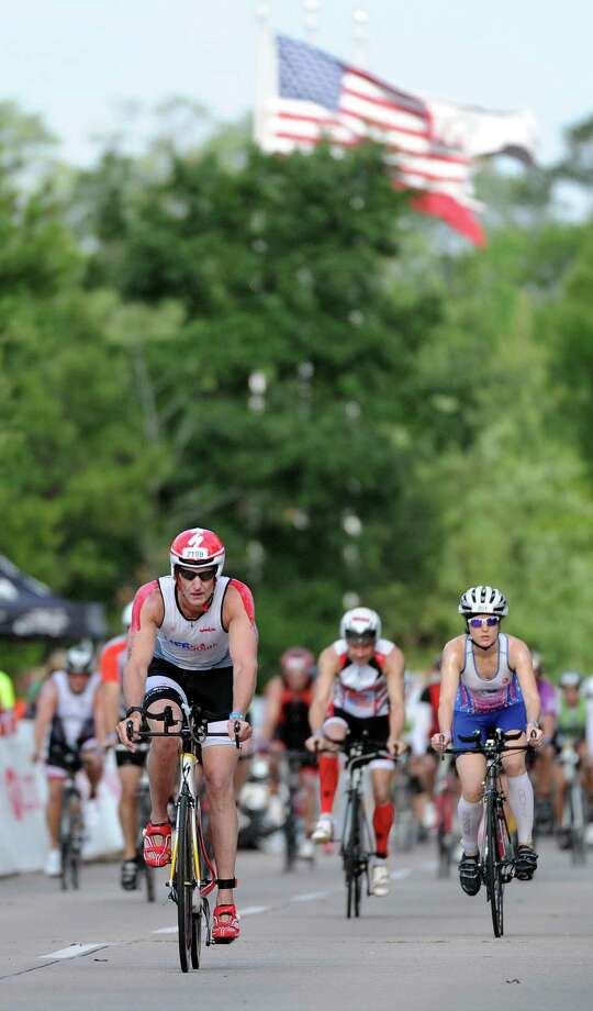 Athletes rode in the 2014 Ironman Texas triathlon. This year's event features a modified bike course that will be 94 miles instead of the traditional 112 miles.  Photo: Eric Christian Smith, Freelance