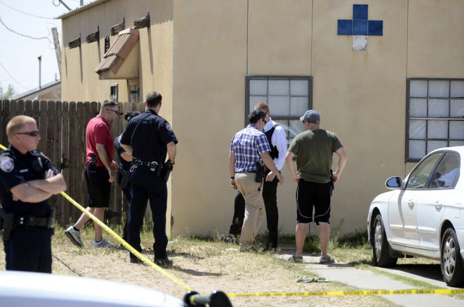 Midland Police cordon off the yard and area around 812 S Carver St. Tuesday afternoon as they investigate a body found in the residence. Tim Fischer\Reporter-Telegram Photo: Tim Fischer