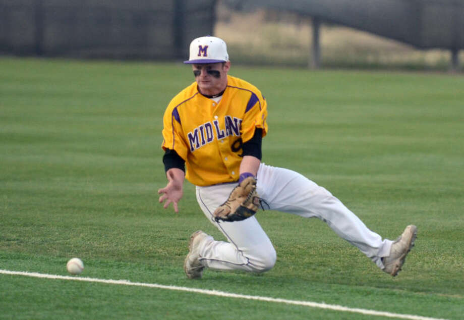 Midland's JM Hillman slides to collect a ground ball from Lee Tuesday at Christensen Stadium. James Durbin/Reporter-Telegram Photo: JAMES DURBIN