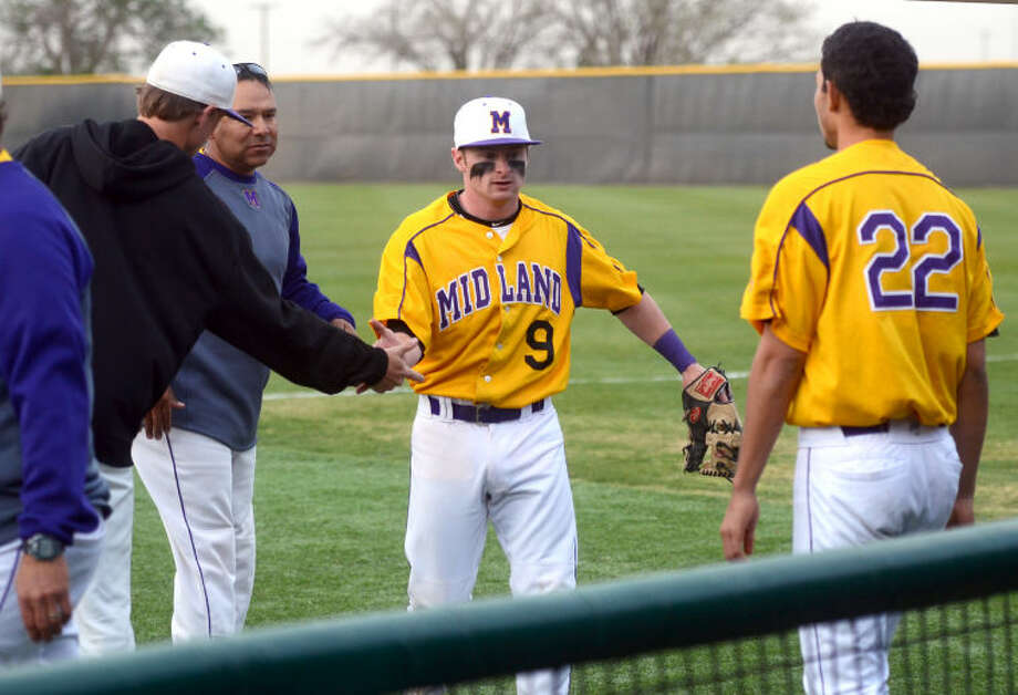 Midland's JM Hillman is congratulated as he returns to the dugout after making a play to end the inning against Lee Tuesday at Christensen Stadium. James Durbin/Reporter-Telegram Photo: JAMES DURBIN