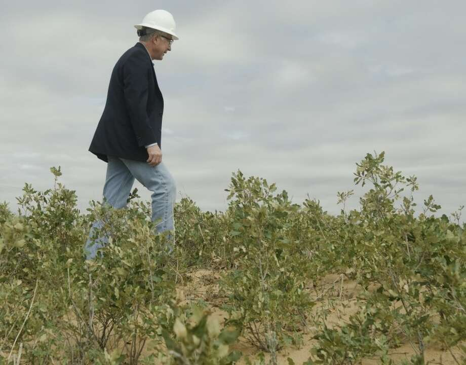 Interior Secretary Ken Salazar takes a walk into a dunes area to look at the Shinnery Oak habitat of the Sagebrush Lizard Wednesday morning on a tour of a well field in Andrews County. Photo by Tim Fischer/Midland Reporter-Telegram Photo: Tim Fischer