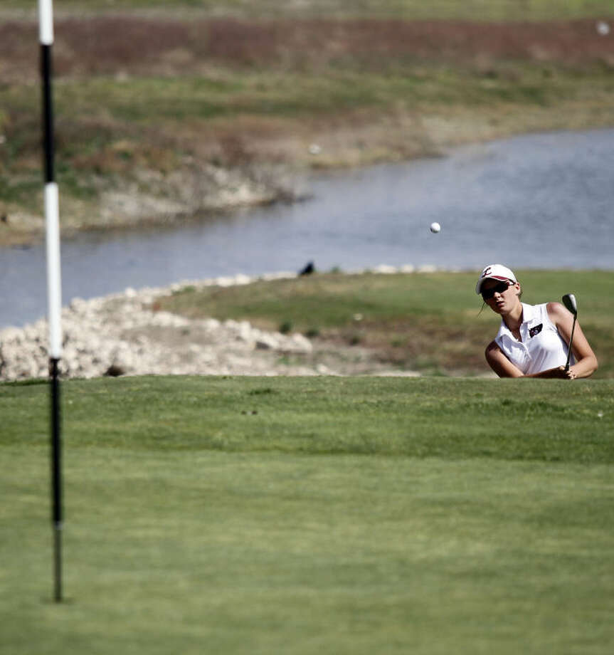 Midland Lee's Ali Cowan hits an approach shot to the 18th hole during Tuesday's girls District 2-5A Golf Championships at the Ratliff Ranch Golf Links. Photo: Edyta Blaszczyk | Odessa America
