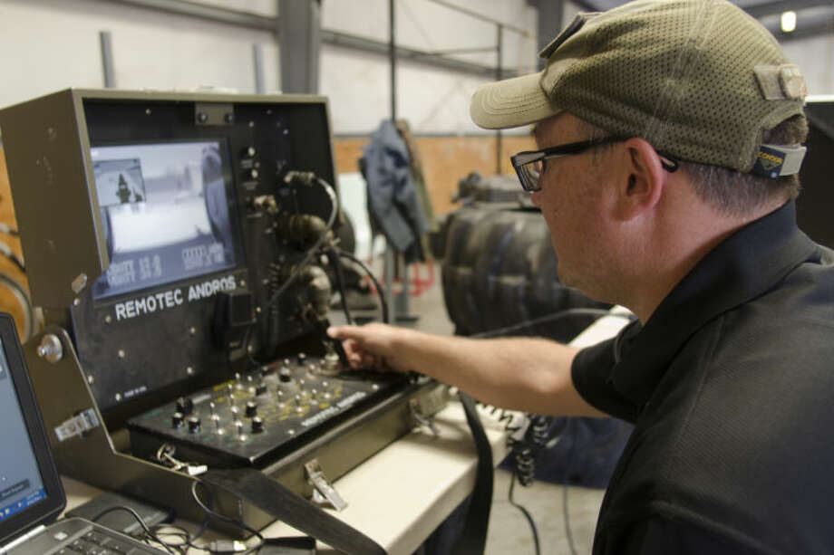 Sgt. Brian Rackow, commander of Midland Police EOD, controls the units robot during training. Tim Fischer\Reporter-Telegram Photo: Tim Fischer
