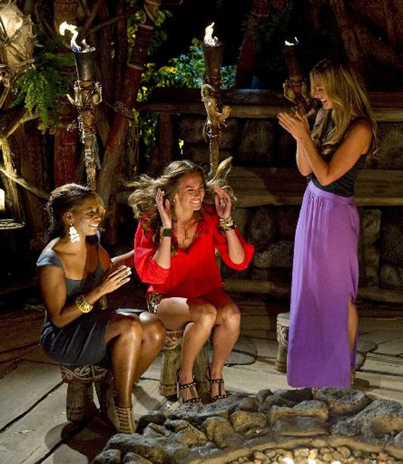"""Survivor: One World"" contestants Kim Spradlin center, Chelsea Meissner, right, and Sabrina Thompson react after Spradlin is crowned sole survivor during the live reunion show in New York on Sunday. Photo: AP/CBS Entertainment"
