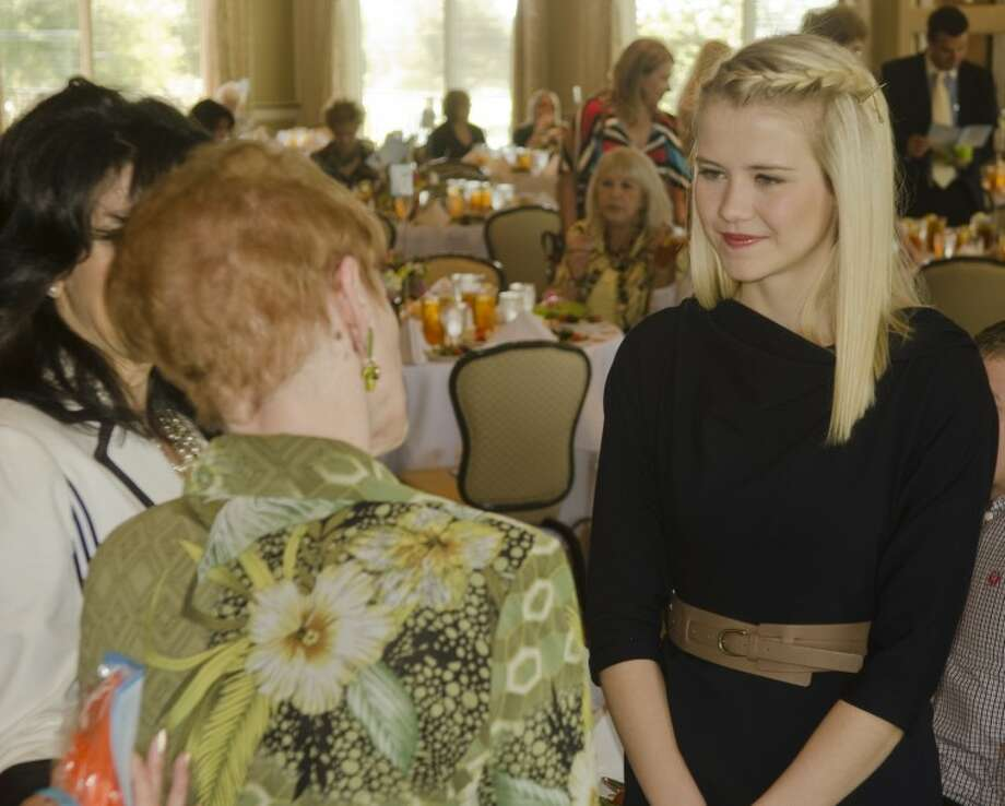 Elizabeth Smart, right, talks with Betty Dickerson and Cynthia Grubb Tuesday morning before the Midland Rape Crisis Center Children's Advocacy Center luncheon. Smart spoke at the fundraiser. Photo: Tim Fischer/Reporter-Telegram