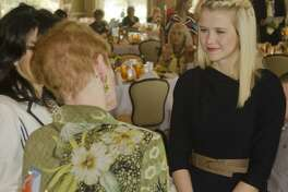 Elizabeth Smart, right, talks with Betty Dickerson and Cynthia Grubb Tuesday morning before the Midland Rape Crisis Center Children's Advocacy Center luncheon. Smart spoke at the fundraiser.