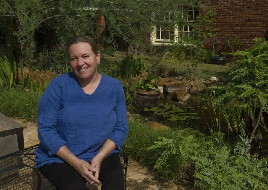 Fran Sherpa has spent years turning her backyard into a garden oasis. Photo by Tim Fischer/Midland Reporter-Telegram Photo: Tim Fischer