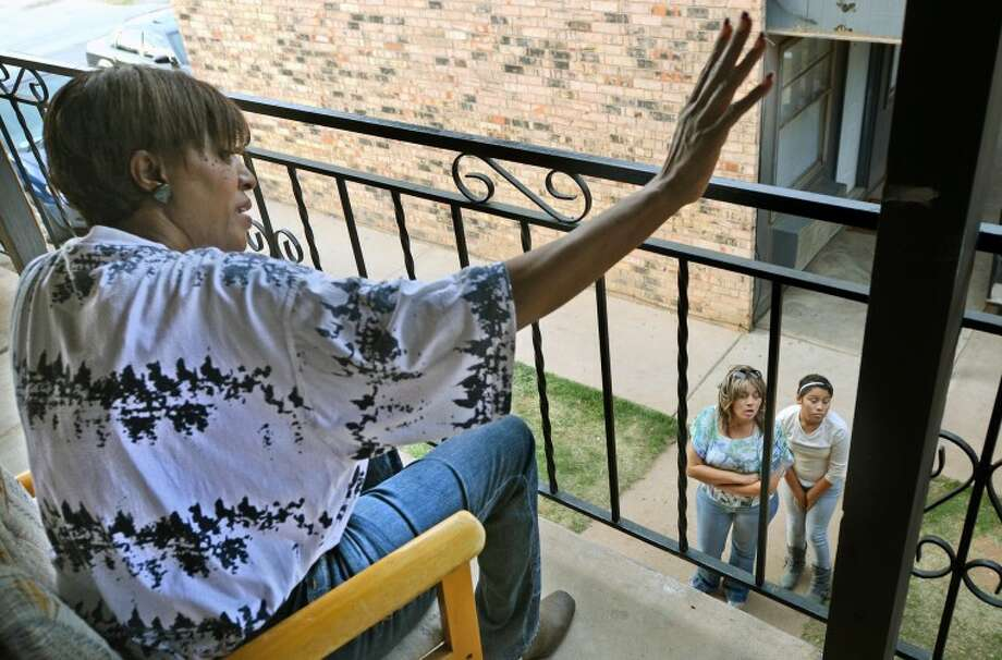 (File Photo) Fretna Banks chats with neighbors outside her second story apartment at the Ocotillo Apartment complex Wednesday. Residents of the Ocotillo Apartments were served eviction notices stating they had one month to move out after the complex was sold. Banks echoes the concerns of many Ocotillo residents, saying she is afraid she doesn't have enough money or time to find housing elsewhere. James Durbin/Reporter-Telegram Photo: JAMES DURBIN