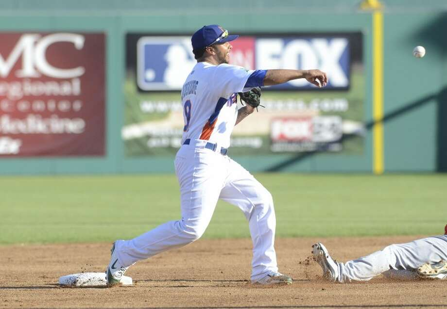 RockHounds second baseman Tyler Ladendorf attempts the double play after outing Frisco's Brad Hawpe during the Hounds game against the Frisco RoughRiders last Wednesday at Citibank Ballpark. Cindeka Nealy/Reporter-Telegram Photo: Cindeka Nealy