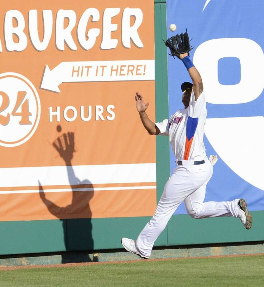 RockHounds center fielder Michael Choice catches a ball hit by Frisco's Chris McGuiness during the RockHounds recent homestand against the RoughRiders at Citibank Ballpark. Cindeka Nealy/Reporter-Telegram Photo: Cindeka Nealy