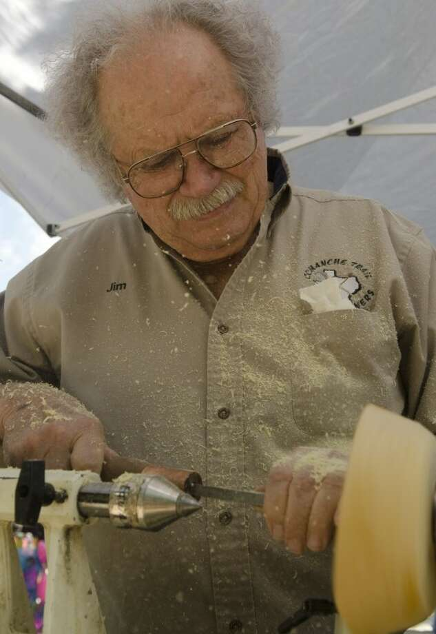 Jim Ketcham, with Comanche Trail Woodturners, turns a bowl Saturday at Celebration of the Arts.  Photo: Tim Fischer/Reporter-Telegram