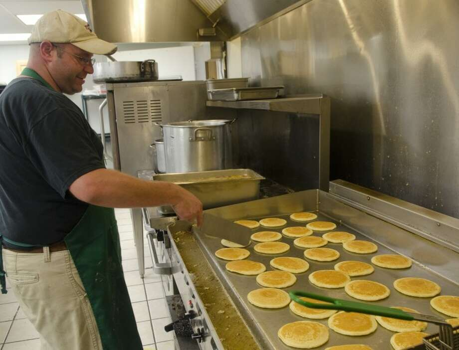 Chance Rohrbaugh, with Teen Challenge, keeps the pancakes coming hot off the grill Saturday during the Pancake Jamboree. Photo: Tim Fischer/Reporter-Telegram