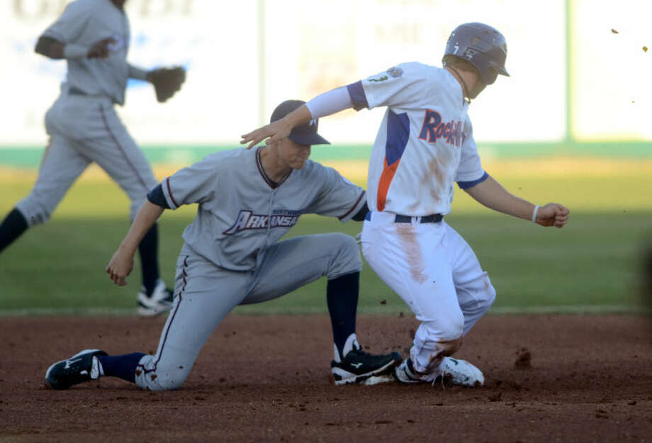 RockHounds' Dusty Coleman pops up after sliding safely into second base against North Arkansas' Alex McClure Thursday at Citibank Ballpark. James Durbin/Reporter-Telegram Photo: JAMES DURBIN